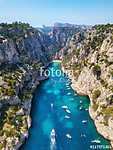 Yachts at the sea in France. Aerial view of luxury floating boat on transparent turquoise water at sunny day. Summer seascape fr vászonkép, poszter vagy falikép