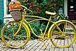 Pierre Auguste Renoir: Sárga kerékpár (id: 3403) vászonkép