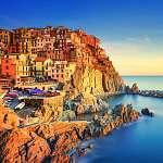 Manarola falu, sziklák és a tenger napnyugtakor. Cinque Terre, O (id: 5142) vászonkép óra