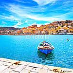 Fából készült kis csónak Porto Santo Stefano tengerpartján. Arge (id: 5171) tapéta