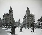 Ferenciek tere (Kígyó tér)-Klotild paloták,háttérben az épülő Erzsébet híd (1902) (id: 20187) falikép keretezve