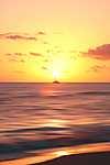 Lemenő nap a tengeren (id: 18297) falikép keretezve