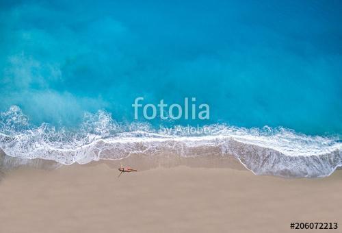woman sunbathing lying down on the tropical beach, Premium Kollekció